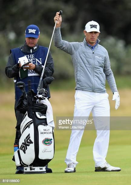 Billy Horschel of the United States selects a club before hitting his second shot on the 1st hole during the first round of the 146th Open...