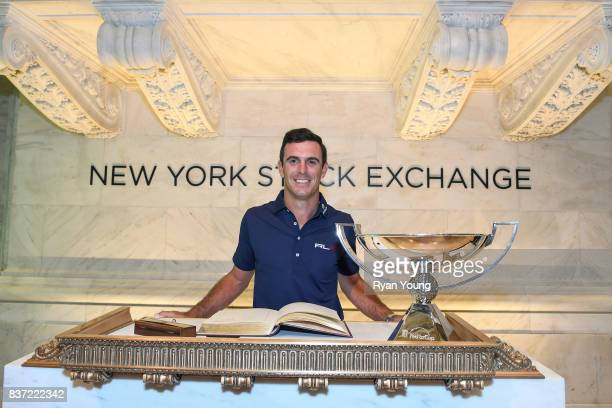 Billy Horschel poses for a photograph with the FedEx Cup trophy and the guest book at the New York Stock Exchange during a preview media tour for THE...