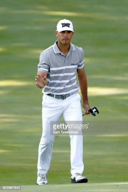 Billy Horschel reacts as he walks to the 18th green during the first round of the World Golf Championships Bridgestone Invitational at Firestone...