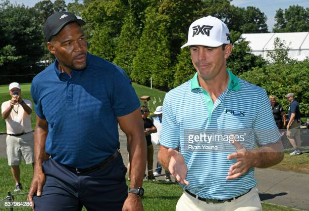 Billy Horschel talks with former NFL player and TV personality Michael Strahan during a proam at THE NORTHERN TRUST at Glen Oaks Club on August 23 in...