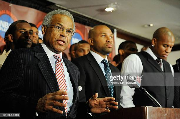 Billy Hunter Executive Director of the National Basketball Players Association speaks next to Derek Fisher President of the National Basketball...