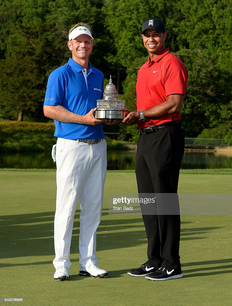 <a gi-track='captionPersonalityLinkClicked' href=/galleries/search?phrase=Billy+Hurley+III&family=editorial&specificpeople=805381 ng-click='$event.stopPropagation()'>Billy Hurley III</a> and <a gi-track='captionPersonalityLinkClicked' href=/galleries/search?phrase=Tiger+Woods&family=editorial&specificpeople=157537 ng-click='$event.stopPropagation()'>Tiger Woods</a> pose with the trophy after the final round of the Quicken Loans National at Congressional Country Club (Blue) on June 26, 2016 in Bethesda, Maryland.