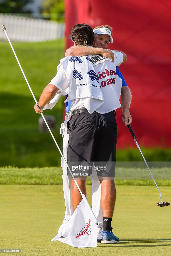 <a gi-track='captionPersonalityLinkClicked' href=/galleries/search?phrase=Billy+Hurley+III&family=editorial&specificpeople=805381 ng-click='$event.stopPropagation()'>Billy Hurley III</a> celebrates his three stroke victory on the 18th hole green with his caddie during the final round of the Quicken Loans National at Congressional Country Club (Blue) on June 26, 2016 in Bethesda, Maryland.