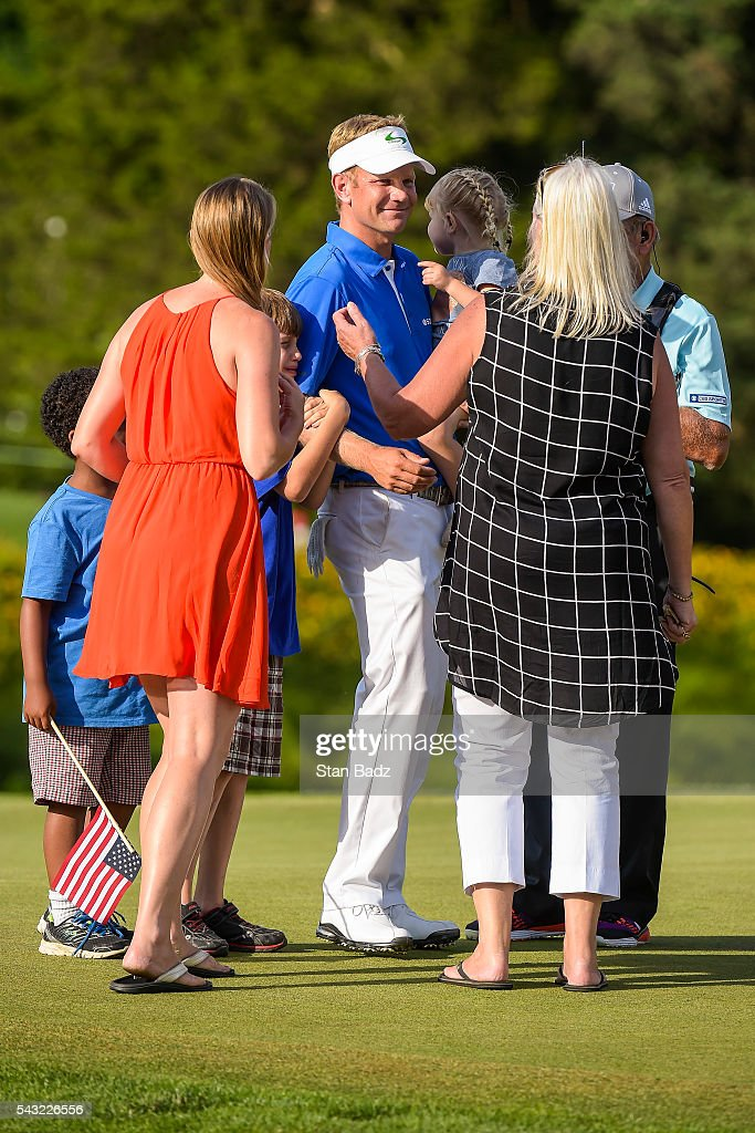 <a gi-track='captionPersonalityLinkClicked' href=/galleries/search?phrase=Billy+Hurley+III&family=editorial&specificpeople=805381 ng-click='$event.stopPropagation()'>Billy Hurley III</a> celebrates his three stroke victory with his wife, children and mother Cheryl on the 18th hole green during the final round of the Quicken Loans National at Congressional Country Club (Blue) on June 26, 2016 in Bethesda, Maryland.