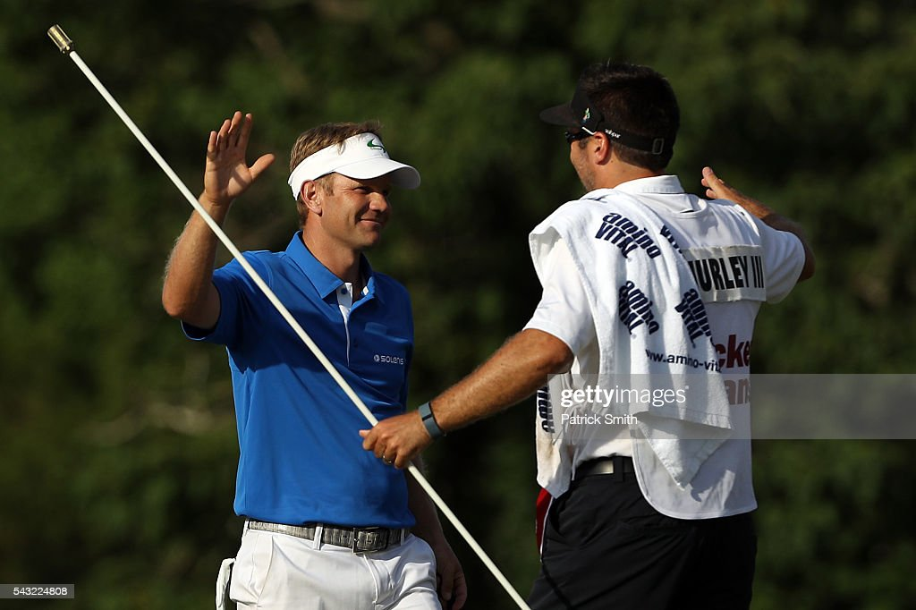 <a gi-track='captionPersonalityLinkClicked' href=/galleries/search?phrase=Billy+Hurley+III&family=editorial&specificpeople=805381 ng-click='$event.stopPropagation()'>Billy Hurley III</a> celebrates with his caddie after winning the Quicken Loans National at Congressional Country Club on June 26, 2016 in Bethesda, Maryland.
