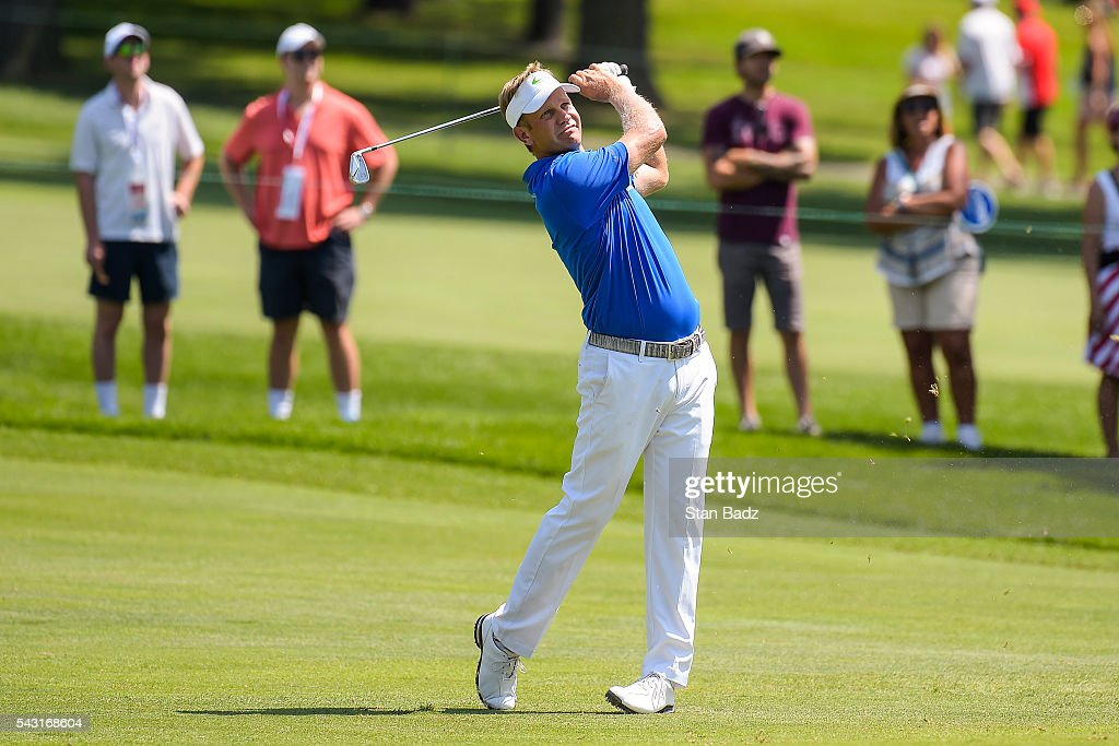 <a gi-track='captionPersonalityLinkClicked' href=/galleries/search?phrase=Billy+Hurley+III&family=editorial&specificpeople=805381 ng-click='$event.stopPropagation()'>Billy Hurley III</a> hits his approach shot on the fourth hole fairway as fans watch during the final round of the Quicken Loans National at Congressional Country Club (Blue) on June 26, 2016 in Bethesda, Maryland.
