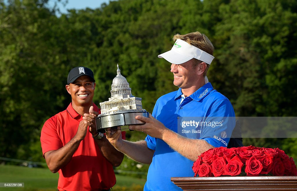 <a gi-track='captionPersonalityLinkClicked' href=/galleries/search?phrase=Billy+Hurley+III&family=editorial&specificpeople=805381 ng-click='$event.stopPropagation()'>Billy Hurley III</a> holds the winner's trophy as <a gi-track='captionPersonalityLinkClicked' href=/galleries/search?phrase=Tiger+Woods&family=editorial&specificpeople=157537 ng-click='$event.stopPropagation()'>Tiger Woods</a> looks on after the final round of the Quicken Loans National at Congressional Country Club (Blue) on June 26, 2016 in Bethesda, Maryland.