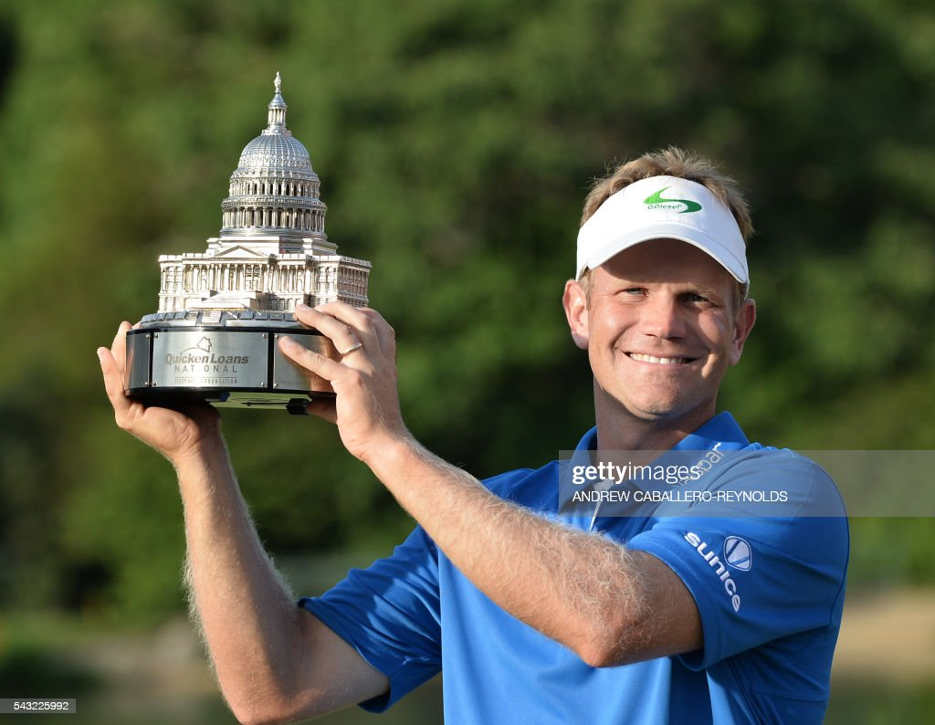 Billy Hurley III holds up the trophy after the final round of the Quicken Loans National at Congressional Country Club in Bethesda, Maryland on June 26, 2016. / AFP / Andrew CABALLERO