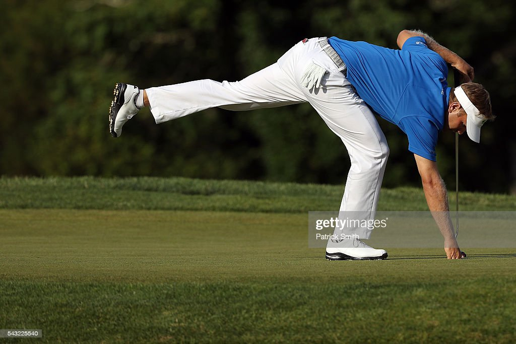 <a gi-track='captionPersonalityLinkClicked' href=/galleries/search?phrase=Billy+Hurley+III&family=editorial&specificpeople=805381 ng-click='$event.stopPropagation()'>Billy Hurley III</a> picks up his ball on the 18th green after winning the Quicken Loans National at Congressional Country Club on June 26, 2016 in Bethesda, Maryland.