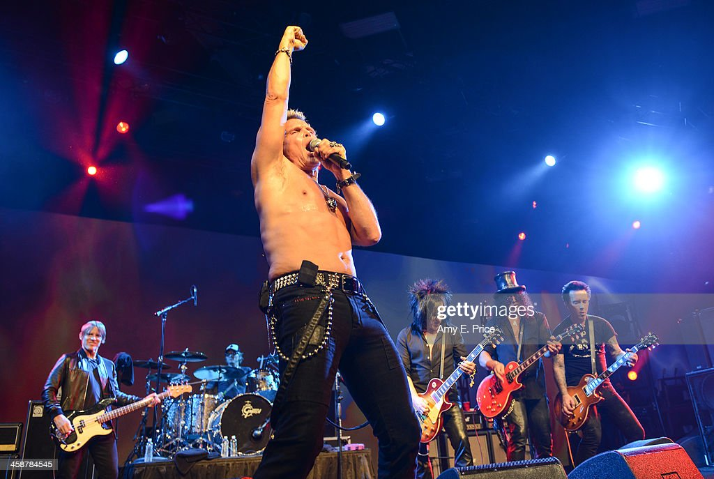<a gi-track='captionPersonalityLinkClicked' href=/galleries/search?phrase=Billy+Idol&family=editorial&specificpeople=138578 ng-click='$event.stopPropagation()'>Billy Idol</a> along with <a gi-track='captionPersonalityLinkClicked' href=/galleries/search?phrase=Chris+Chaney&family=editorial&specificpeople=614601 ng-click='$event.stopPropagation()'>Chris Chaney</a>, <a gi-track='captionPersonalityLinkClicked' href=/galleries/search?phrase=Matt+Sorum&family=editorial&specificpeople=213836 ng-click='$event.stopPropagation()'>Matt Sorum</a>, <a gi-track='captionPersonalityLinkClicked' href=/galleries/search?phrase=Steve+Stevens&family=editorial&specificpeople=225031 ng-click='$event.stopPropagation()'>Steve Stevens</a>, Slash and Billy Morrison performs with Camp Freddy at the Austin Convention Center on December 11, 2013 in Austin, Texas.
