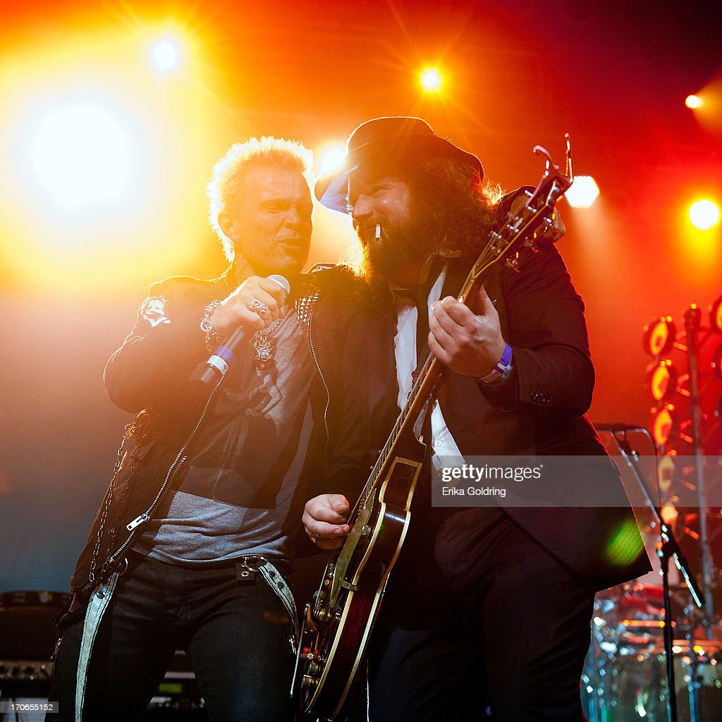 Billy Idol and and Jim James (R) perform as part of the Super Jam during the 2013 Bonnaroo Music & Arts Festival on June 15, 2013 in Manchester, Tennessee.
