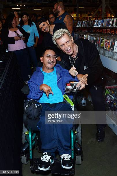 Billy Idol performs a special acoustic set and signing for his new album 'Kings Queens Of The Underground' at Amoeba Music on October 22 2014 in...