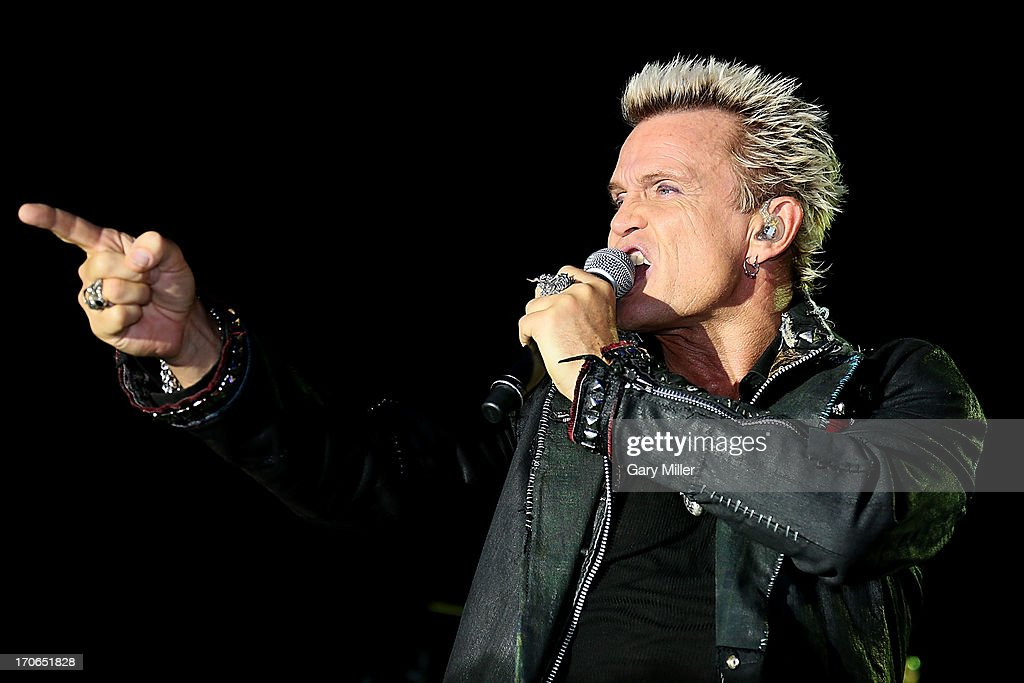 <a gi-track='captionPersonalityLinkClicked' href=/galleries/search?phrase=Billy+Idol&family=editorial&specificpeople=138578 ng-click='$event.stopPropagation()'>Billy Idol</a> performs in concert during day 3 of the 2013 Bonnaroo Music & Arts Festival on June 15, 2013 in Manchester, Tennessee.
