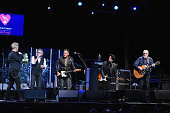 Billy Idol Roger Daltrey Bruce Springsteen Willie Nile and Pete Townshend perform onstage during the MusiCares MAP Fund Benefit Concert at Best Buy...
