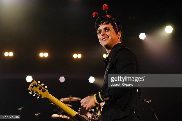Billy Joe Armstrong of Green Day performs on stage at Brixton Academy on August 21 2013 in London England