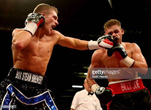 Billy Joe Saunders in action with Nick Blackwell during their Commonwealth and Vacant British Middleweight Championship bout at ExCel on December 15...