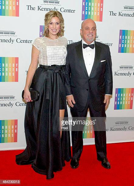 Billy Joel and Alexis Roderick arrive at the formal Artist's Dinner honoring the recipients of the 2013 Kennedy Center Honors hosted by United States...