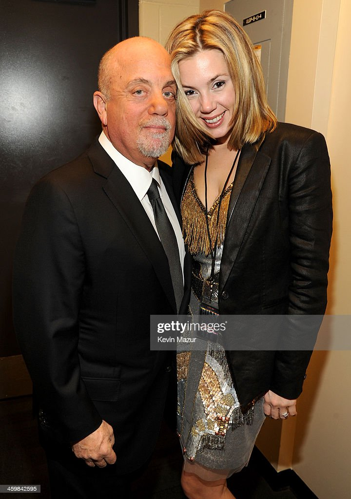 <a gi-track='captionPersonalityLinkClicked' href=/galleries/search?phrase=Billy+Joel&family=editorial&specificpeople=203097 ng-click='$event.stopPropagation()'>Billy Joel</a> and <a gi-track='captionPersonalityLinkClicked' href=/galleries/search?phrase=Alexis+Roderick&family=editorial&specificpeople=8355331 ng-click='$event.stopPropagation()'>Alexis Roderick</a> pose backstage at the <a gi-track='captionPersonalityLinkClicked' href=/galleries/search?phrase=Billy+Joel&family=editorial&specificpeople=203097 ng-click='$event.stopPropagation()'>Billy Joel</a> New Year's Eve Concert at the Barclays Center of Brooklyn on December 31, 2013 in New York City.
