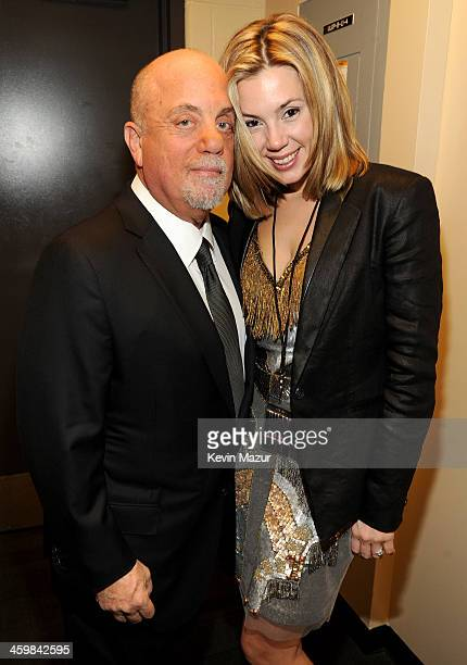 Billy Joel and Alexis Roderick pose backstage at the Billy Joel New Year's Eve Concert at the Barclays Center of Brooklyn on December 31 2013 in New...