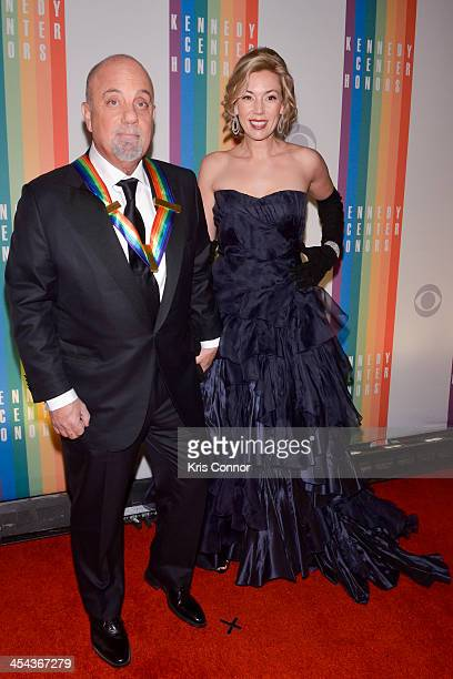 Billy Joel and Alexis Roderick pose on the red carpet during the The 36th Kennedy Center Honors gala at the Kennedy Center on December 8 2013 in...