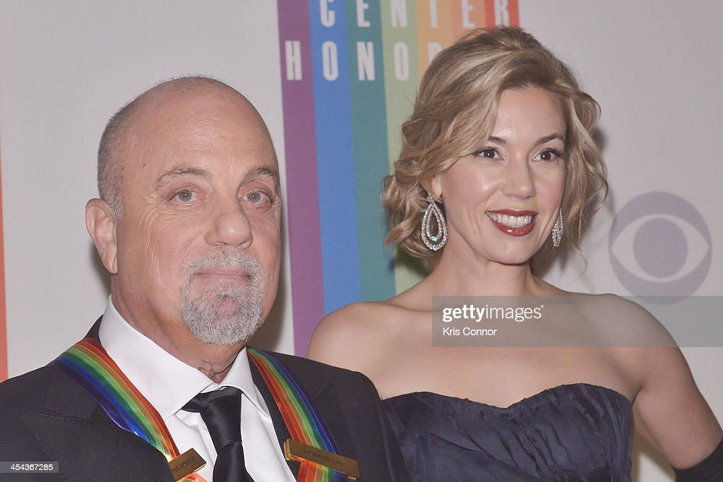 <a gi-track='captionPersonalityLinkClicked' href=/galleries/search?phrase=Billy+Joel&family=editorial&specificpeople=203097 ng-click='$event.stopPropagation()'>Billy Joel</a> and <a gi-track='captionPersonalityLinkClicked' href=/galleries/search?phrase=Alexis+Roderick&family=editorial&specificpeople=8355331 ng-click='$event.stopPropagation()'>Alexis Roderick</a> pose on the red carpet during the The 36th Kennedy Center Honors gala at the Kennedy Center on December 8, 2013 in Washington, DC.