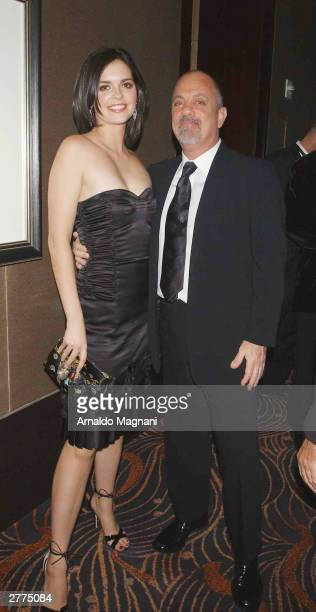 Billy Joel and girlfriend Kate Lee attend the gala opening of the Mandarin Oriental New York at the Mandarin Oriental December 1 2003 in New York City