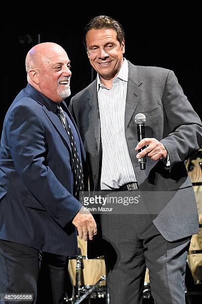 Billy Joel and Governor of New York Andrew Cuomo appear onstage during the final show at Nassau Coliseum on August 4 2015 in Long Island New York
