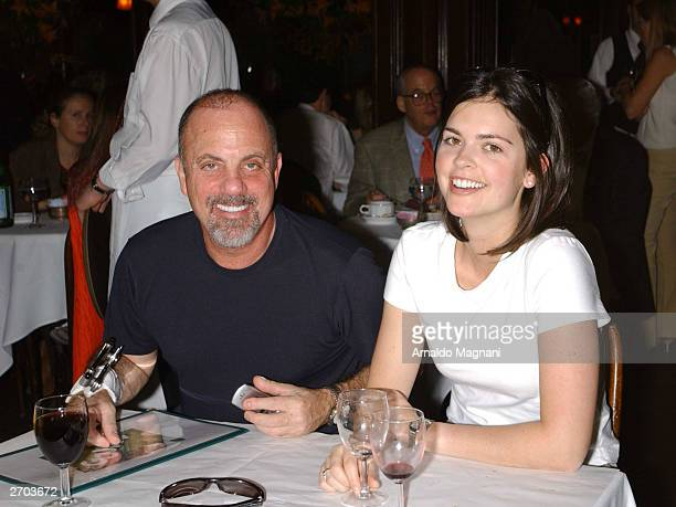 Billy Joel and his girlfriend Kate Lee have a glass of wine at La Goulue November 3 2003 in New York