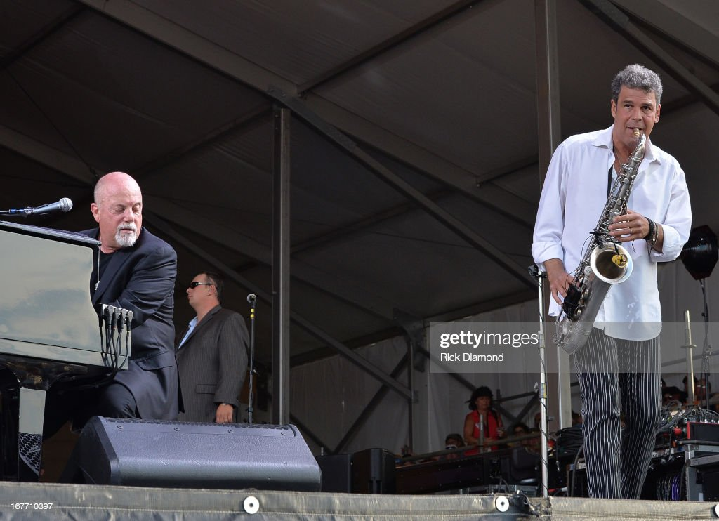 <a gi-track='captionPersonalityLinkClicked' href=/galleries/search?phrase=Billy+Joel&family=editorial&specificpeople=203097 ng-click='$event.stopPropagation()'>Billy Joel</a> and Mark Rivera perform during the 2013 New Orleans Jazz & Heritage Music Festival at Fair Grounds Race Course on April 27, 2013 in New Orleans, Louisiana.