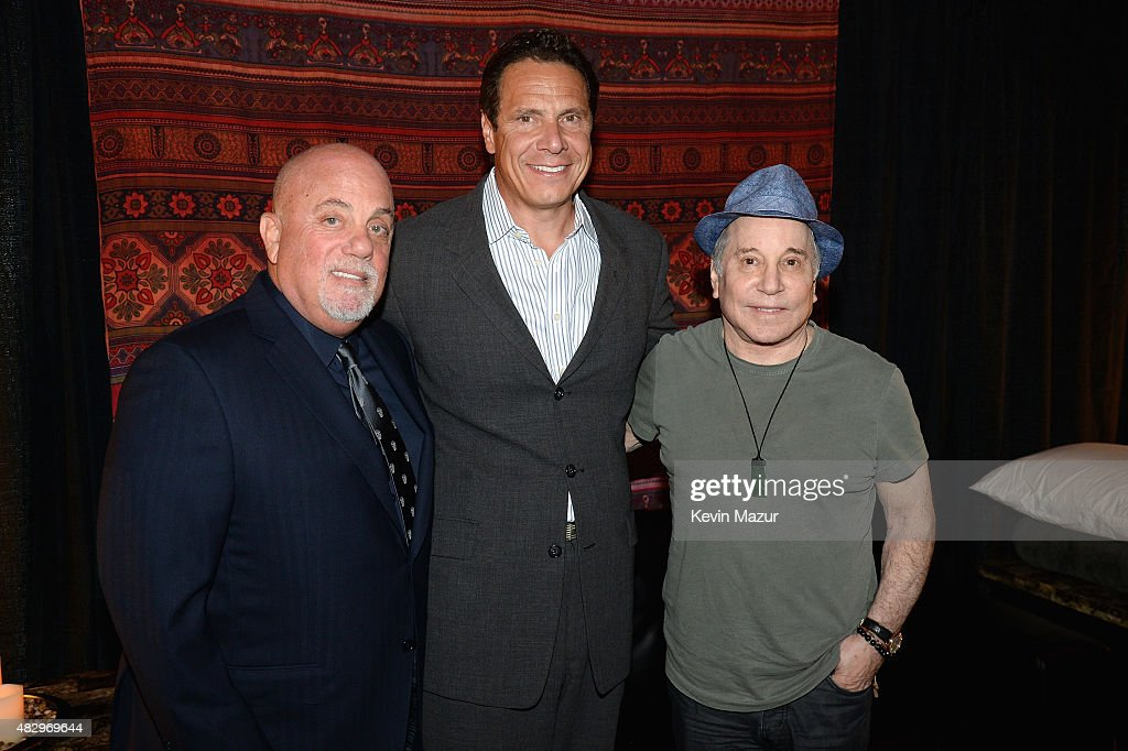 Billy Joel Governor of New York Andrew Cuomo and Paul Simon pose backstage at the final show at Nassau Coliseum on August 4 2015 in Long Island New...