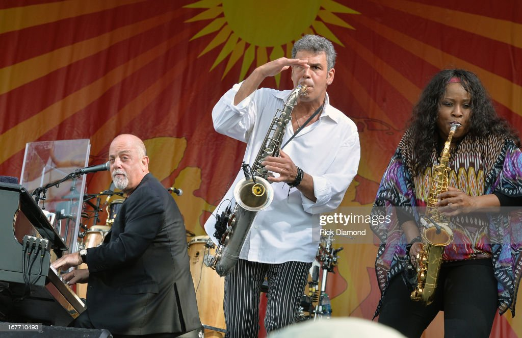 <a gi-track='captionPersonalityLinkClicked' href=/galleries/search?phrase=Billy+Joel&family=editorial&specificpeople=203097 ng-click='$event.stopPropagation()'>Billy Joel</a>, Mark Rivera and Crystal Taliefero perform during the 2013 New Orleans Jazz & Heritage Music Festival at Fair Grounds Race Course on April 27, 2013 in New Orleans, Louisiana.