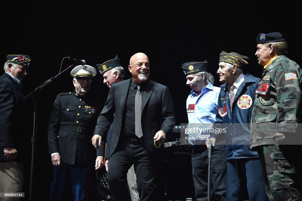 Billy Joel perfoms onstage with Veterans during 'Goodnight Saigon' at the newly rennovated Nassau Coliseum, Long Island on April 5, 2017 in New York City.