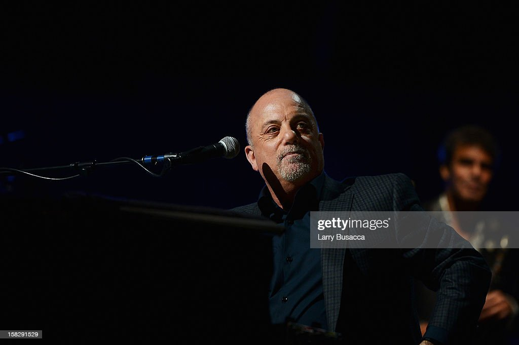 <a gi-track='captionPersonalityLinkClicked' href=/galleries/search?phrase=Billy+Joel&family=editorial&specificpeople=203097 ng-click='$event.stopPropagation()'>Billy Joel</a> performs at '12-12-12' a concert benefiting The Robin Hood Relief Fund to aid the victims of Hurricane Sandy presented by Clear Channel Media & Entertainment, The Madison Square Garden Company and The Weinstein Company at Madison Square Garden on December 12, 2012 in New York City.