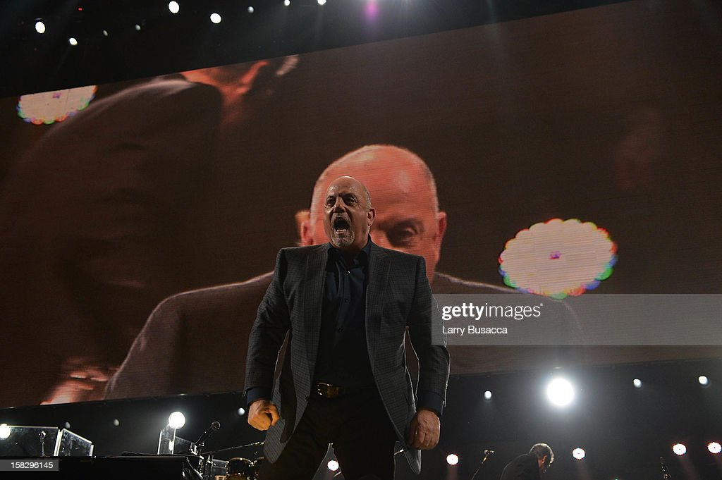 Billy Joel performs at '12-12-12' a concert benefiting The Robin Hood Relief Fund to aid the victims of Hurricane Sandy presented by Clear Channel Media & Entertainment, The Madison Square Garden Company and The Weinstein Company at Madison Square Garden on December 12, 2012 in New York City.