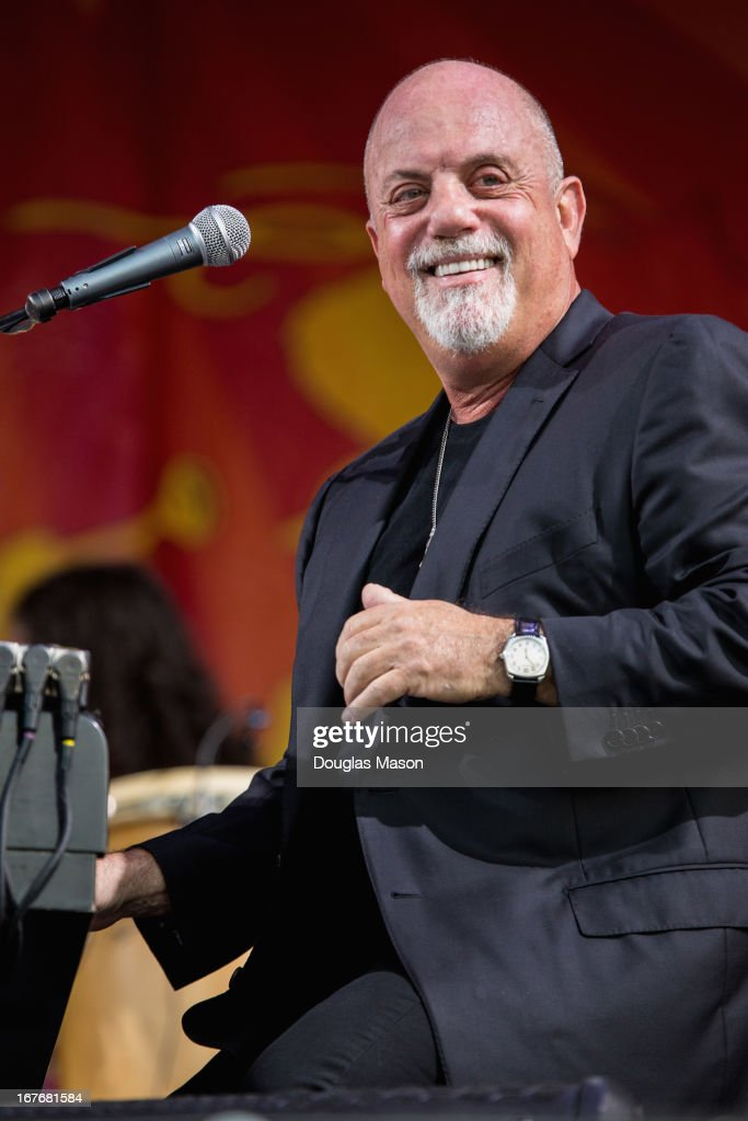 <a gi-track='captionPersonalityLinkClicked' href=/galleries/search?phrase=Billy+Joel&family=editorial&specificpeople=203097 ng-click='$event.stopPropagation()'>Billy Joel</a> performs during the 2013 New Orleans Jazz & Heritage Music Festival at Fair Grounds Race Course on April 27, 2013 in New Orleans, Louisiana.