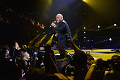Billy Joel performs during the final show at Nassau Coliseum on August 4 2015 in Long Island New York