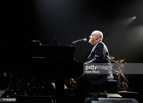 Billy Joel performs on stage during STING 25th Anniversary/60th Birthday Concert to Benefit Robin Hood Foundation at Beacon Theatre on October 1 2011...