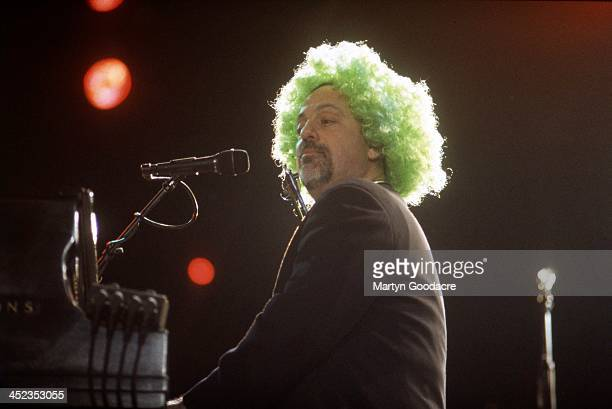 Billy Joel performs on stage in a joint concert with Elton John at Croke Park Stadium in Dublin Ireland 29th May 1998
