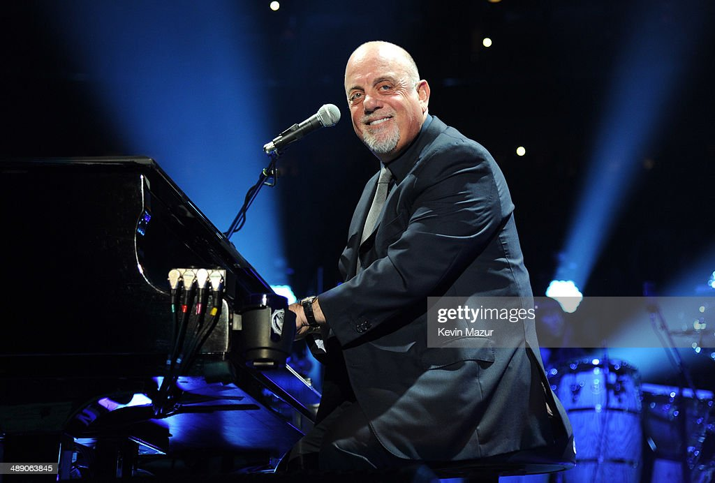 <a gi-track='captionPersonalityLinkClicked' href=/galleries/search?phrase=Billy+Joel&family=editorial&specificpeople=203097 ng-click='$event.stopPropagation()'>Billy Joel</a> performs onstage celebrating his 65th birthday at Madison Square Garden on May 9, 2014 in New York City.