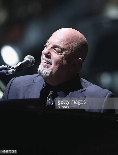 Billy Joel smiles when he performs at Madison Square Garden on August 20 2015 in New York City