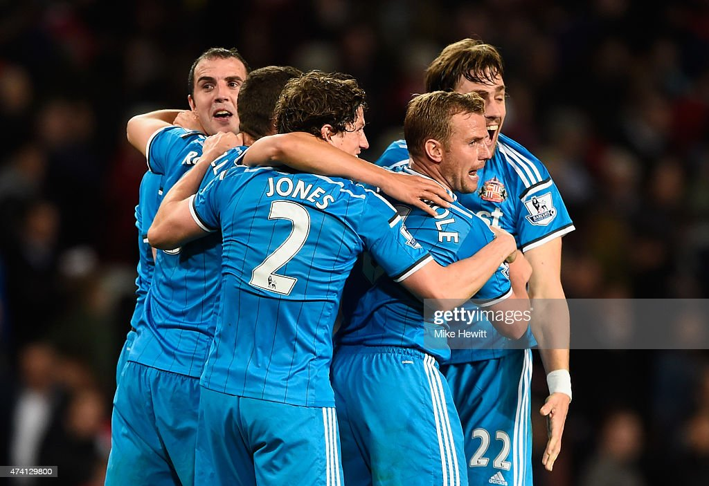 Billy Jones and Lee Cattermole of Sunderland celebrate securing Premier League safety with team mates after the Barclays Premier League match between...