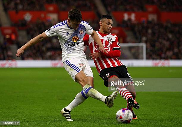 Billy Jones of Sunderland is tackled by Sofiane Boufal of Southampton during the EFL Cup fourth round match between Southampton and Sunderland at St...
