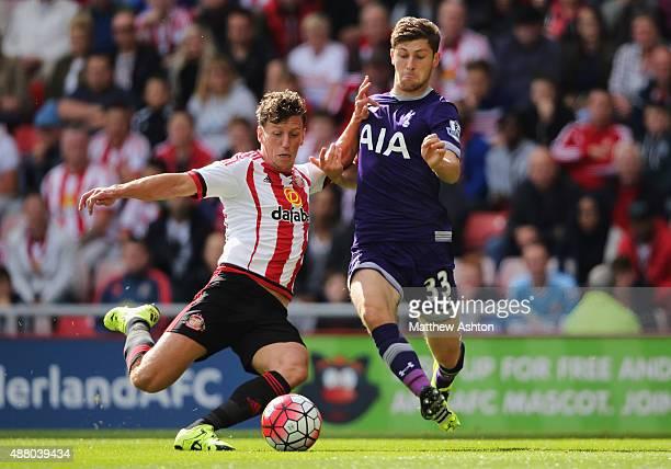 Billy Jones of Sunderland tackles Ben Davies of Tottenham Hotspur during the Barclays Premier League match between Sunderland and Tottenham Hotspur...