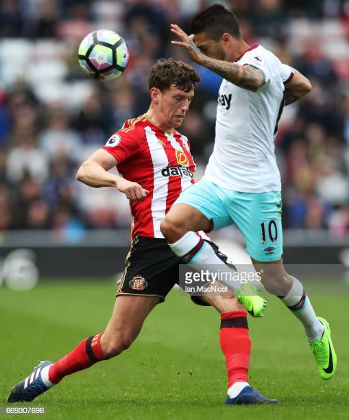 Billy Jones of Sunderland vies with Manuel Lanzini of West Ham United during the Premier League match between Sunderland and West Ham United at...