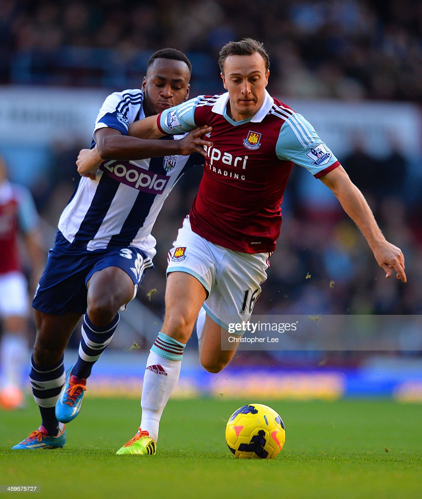 Billy Jones of West Brom and Mark Noble of West Ham battle for the ball during the Barclays Premier League match between West Ham United and West Bromwich Albion at Boleyn Ground on December 28, 2013 in London, England.