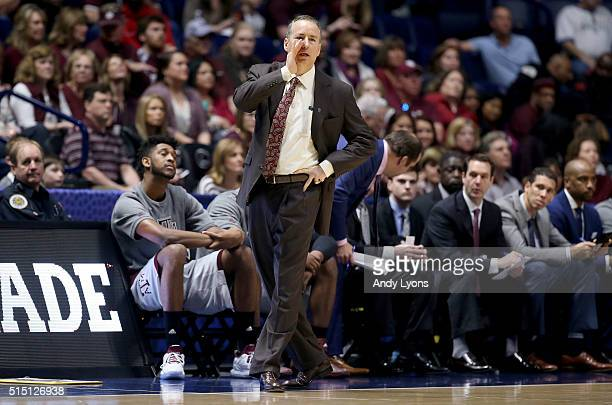 Billy Kennedy the head coach of the Texas AM Aggies gives instructions to his team in the game against the LSU Tigers during the semifinals of the...