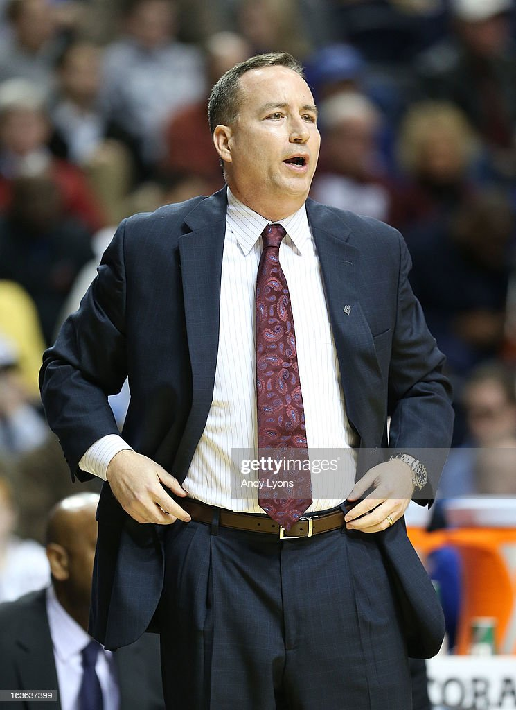 <a gi-track='captionPersonalityLinkClicked' href=/galleries/search?phrase=Billy+Kennedy+-+Basketball+Coach&family=editorial&specificpeople=15285545 ng-click='$event.stopPropagation()'>Billy Kennedy</a> the head coach of the Texas A&M Aggies gives instructions to his team during the game against the Auburn Tigers during the first round game of the Southeastern Conference Tournament at Bridgestone Arena on March 13, 2013 in Nashville, Tennessee.