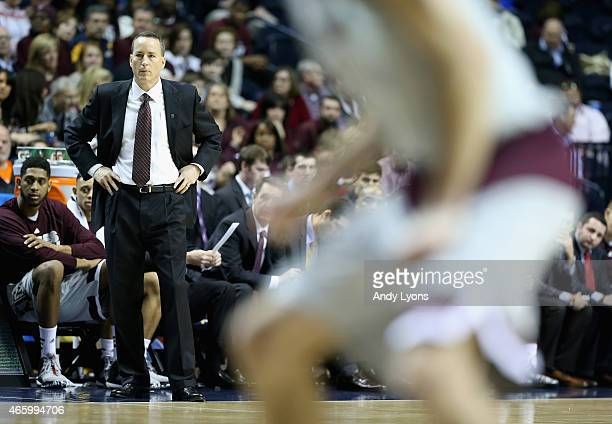 Billy Kennedy the head coach of the Texas AM Aggies gives instructions to his team against the Auburn Tigers during the second round game of the SEC...