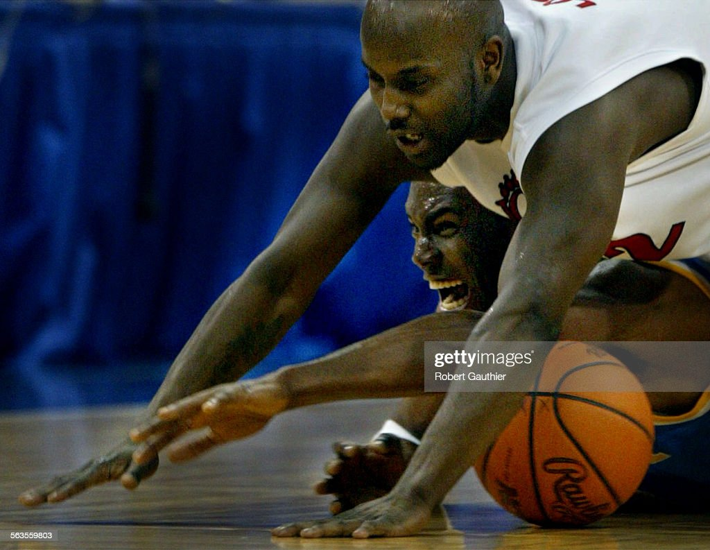 Billy Knight of UCLA and Steve Logan of Cincinnati battle for a