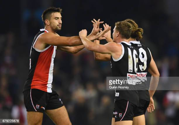 Billy Longer Jack Newnes and Jack Steele of the Saints celebrate winning the round seven AFL match between the St Kilda Saints and the Greater...